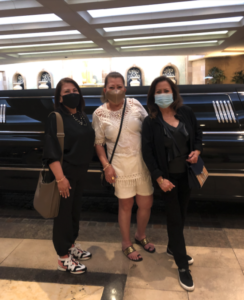 A luxury limousine ride with an entourage of fast cars: Ms. M with sisters Alice and Myrna.